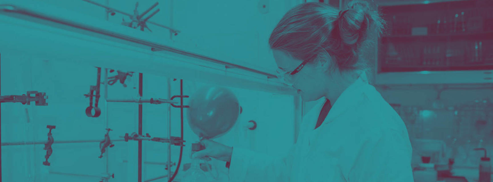 Banner photograph of a woman in lab