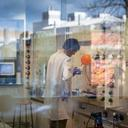 Photo of person in a laboratory undertaking research